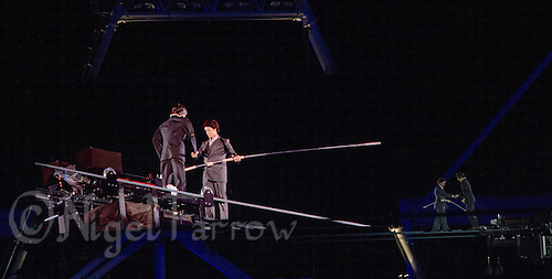 """12 AUG 2012 - LONDON, GBR - A tightrope artist performs during the """"A Symphony of British Music"""" section of the London 2012 Olympic Games Closing Ceremony in the Olympic Stadium in the Olympic Park, Stratford, London, Great Britain .(PHOTO (C) 2012 NIGEL FARROW)"""