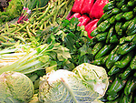 Vegetables at produce stand at La Boqueria (public market) in Barcelona, Spain.