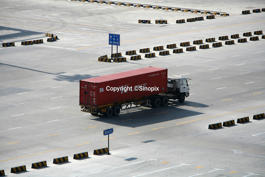 A truck enters the Yangshan Deep Water Port near Shanghai, China..11 Feb 2007