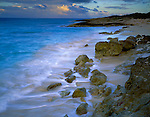 Anguilla, BWI  <br /> Morning clouds over Atlantic Ocean with surf on a pocket beach near Island Harbor.  Windward Islands of the Caribbeanst