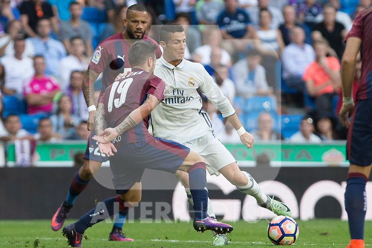 Real Madrid's Cristiano Ronaldo and Eibar's Antonio Luna during the match of La Liga between Real Madrid and SD Eibar at Santiago Bernabeu Stadium in Madrid. October 02, 2016. (ALTERPHOTOS/Rodrigo Jimenez)