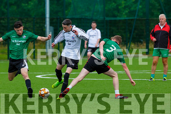 Tommy Feehan Castleisland white team is tackled by Mike Hanafin and Kevin McMahon during Castleisland training game in their field on Sunday first game in the field since lockdown