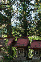 An old shrine, tucked among leafy trees, near Nobushina, Nagano, Japan, seems almost forgotten.