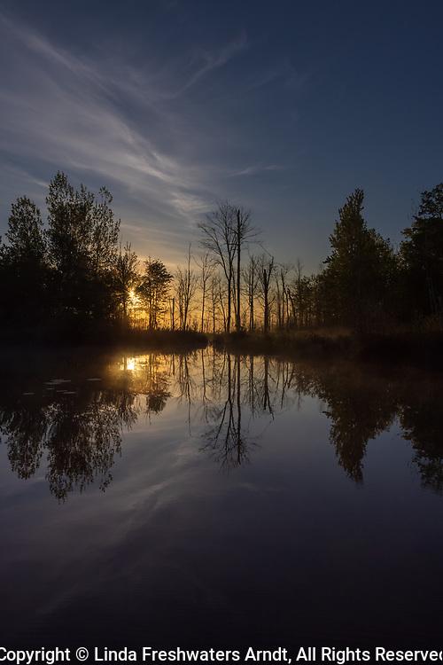A misty sunrise on a northern Wisconsin lake.