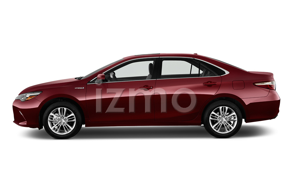 Car driver side profile view of a 2015 Toyota camry hybrid 4 Door Sedan