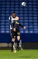 Bolton Wanderers' Reiss Greenidge (left) beats Newcastle United U21's Elliot Anderson in the air<br /> <br /> Photographer Andrew Kearns/CameraSport<br /> <br /> EFL Papa John's Trophy - Northern Section - Group C - Bolton Wanderers v Newcastle United U21 - Tuesday 17th November 2020 - University of Bolton Stadium - Bolton<br />  <br /> World Copyright © 2020 CameraSport. All rights reserved. 43 Linden Ave. Countesthorpe. Leicester. England. LE8 5PG - Tel: +44 (0) 116 277 4147 - admin@camerasport.com - www.camerasport.com