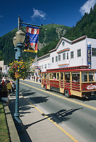 Trolley car travels the streets of downtown Juneau on a sunny day, southeast, Alaska.