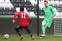 Sunday 18 March 2018<br /> Pictured:  Steven Benda of Swansea City is marked by Tosin Kehinde of Manchester United<br /> Re: Swansea City v Manchester United U23s in the Premier League 2 at The Liberty Stadium on March 18, 2018 in Swansea, Wales.