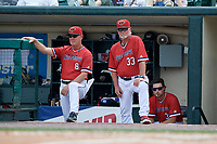 Rochester Red Wings manager Mike Quade (8) and pitching coach Stu Cliburn (33) during a game against the Columbus Clippers on August 9, 2017 at Frontier Field in Rochester, New York.  Rochester defeated Columbus 12-3.  (Mike Janes/Four Seam Images)