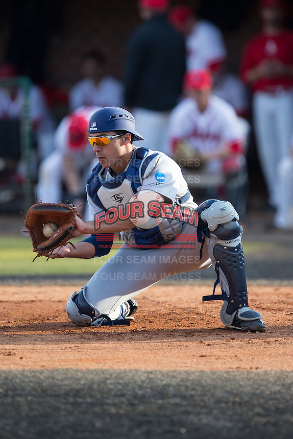 Catawba Indians catcher Zach Queen (21) takes a throw during infield practice prior to the game against the Belmont Abbey Crusaders at Abbey Yard on February 7, 2017 in Belmont, North Carolina.  The Crusaders defeated the Indians 12-9.  (Brian Westerholt/Four Seam Images)