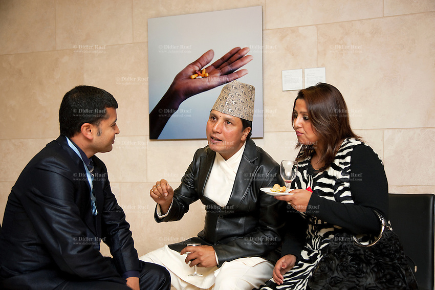 Switzerland. Geneva. World Health Organisation (WHO). Stop TB Partnership. Evening party for a group of national ambassadors against tuberculosis. Deepak Raj Giri (C), Nepal, TV movie actor. Deespasri Niraula (R), Nepal, TV movie actress. 5.12.2011 © WHO /Didier Ruef