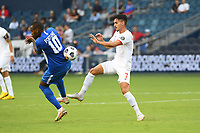 KANSASCITY, KS - JULY 11: Stephen Eustaquio #7 of Canada ,Kevin Fortune #10 of Martinique during a game between Canada and Martinique at Children's Mercy Park on July 11, 2021 in KansasCity, Kansas.