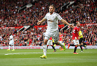 Pictured: Gylfi Sigurdsson of Swansea celebrating his goal, making the score 2-1 to his team. Saturday 16 August 2014<br />