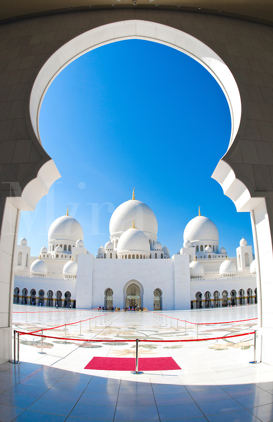 The beautiful interior of the white Sheikh Zayed Grand Mosque in Abu Dhabi in the UAE the worlds 8th largest Muslim mosque in the world in United Arab Emirates