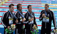 From left, France's Frederick Bousquet,  Gregory Mallet, Fabien Gilot and Alain Bernard, celebrate their bronze medal on the podium after the men's 4x100 meters freestyle swimming final at the Swimming World Championships in Rome, 26 July 2009..UPDATE IMAGES PRESS/Riccardo De Luca