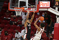 Georgia Andrew Garcia (4) blocks Arkansas guard Moses Moody (5), Saturday, January 9, 2021 during the second half of a basketball game at Bud Walton Arena in Fayetteville. Check out nwaonline.com/210110Daily/ for today's photo gallery. <br /> (NWA Democrat-Gazette/Charlie Kaijo)