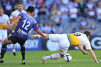 MELBOURNE, AUSTRALIA - JANUARY 26, 2010: Rodrigo Vargas from Melbourne Victory chases the ball as Chris Greenacre goes to ground in round 19 of the A-league match between Melbourne Victory and Wellington Phoenix FC at Etihad Stadium on January 26, 2010 in Melbourne, Australia. Photo Sydney Low www.syd-low.com