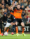 Dundee's Luka Tankulic and Dundee Utd's Callum Morris challenge for the ball.