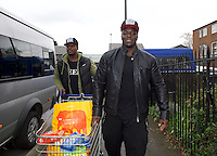 Adebayo Akinfenwa of Wycombe Wanderers - How the strongest man in football is spreading the Christmas cheer. <br /> <br /> Interview and feature will be shown on Sky Sports News HQ and across Sky Sports digital platforms Christmas Day.<br /> <br /> Bayo Akinfenwa (right) and his brother Dele Akinz carry food donations from his car as he helps out at a Food Bank in Lewisham, England on 23 December 2016.  <br /> <br /> Photo by Alan  Stanford / PRiME Media Images.
