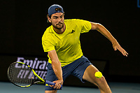 10th February 2021, Melbourne, Victoria, Australia; Maxime Cressy of the United States of America returns the ball during round 2 of the 2021 Australian Open on February 10 2020, at Melbourne Park in Melbourne, Australia.