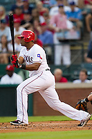 Texas Rangers third baseman Adrian Beltre #29 swings during the Major League Baseball game against the Baltimore Orioles on August 21st, 2012 at the Rangers Ballpark in Arlington, Texas. The Orioles defeated the Rangers 5-3. (Andrew Woolley/Four Seam Images).