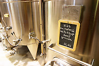 Domaine Hortus AOC Pic St Loup 2005 Grenache. Domaine de l'Hortus. Pic St Loup. Languedoc. Sign on tank. Stainless steel fermentation and storage tanks. France. Europe.