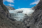 The Franz Josef Glacier, or what's left of it, on the west coast of the south island of New Zealand, viewed from the top of a terminal moraine left by the receding glacier.