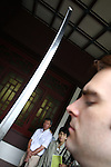 June 26, 2010 - Tokyo, Japan - A visitor inspects a long sword (katana) during The 1st Sword Craftsmen Exhibition of the NBSK (Nihon Bunka Shinko Kyokai) at Okura Musem of Art located in Okura Hotel in Tokyo, Japan, on June 26, 2010. The event runs from June 13 to July 25 and let sword masters show their skills such as sword polishing, sword fittings and mounting to visitors.