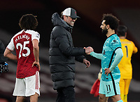 April 3rd 2021; Emriates Stadium, London, England;  Liverpools manager Jurgen Klopp congratulates Mohamed Salah after their 0-3 win in the Premier League match between Arsenal and Liverpool at the Emirates Stadium in London
