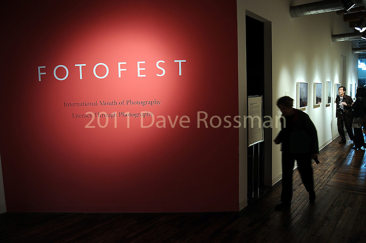 Guests begin to browse the work at the Fotofest 2010 Biennial opening party Friday March 12,2010. (Dave Rossman Photo)