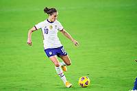ORLANDO, FL - JANUARY 18: Carli Lloyd #10 of the USWNT kicks the ball during a game between Colombia and USWNT at Exploria Stadium on January 18, 2021 in Orlando, Florida.