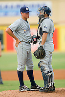 Catcher Jake Jefferies #8 of the Charlotte Stone Crabs has a chat with pitcher Matthew Moore #36 during a Florida State League game against the Jupiter Hammerheads at Roger Dean Stadium June 15, 2010, in Jupiter, Florida.  Photo by Brian Westerholt /  Seam Images