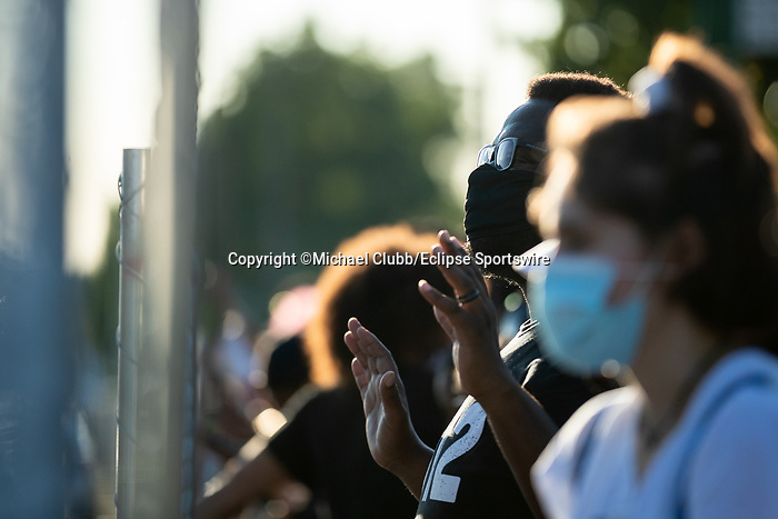 "September 5, 2020:  A Black Lives Matter protester holds their hands up towards police outside of Churchill Downs  the 146th Kentucky Derby. With the Kentucky Derby being the biggest sports event for the State of Kentucky, protestors have chosen the  event as a focal point for their calls for justice in the death of Breonna Taylor. Multiple groups from around the country have converged on Louisville to protest during the ""Run for the Roses"" at Churchill Downs in Louisville. Michael Clubb/Eclipse Sportswire/CSM"