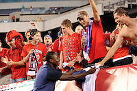 Freddy Adu signs autographs for fans before the game. The men's national teams of the United States (USA) and Mexico (MEX) played to a 1-1 tie during an international friendly at Lincoln Financial Field in Philadelphia, PA, on August 10, 2011.
