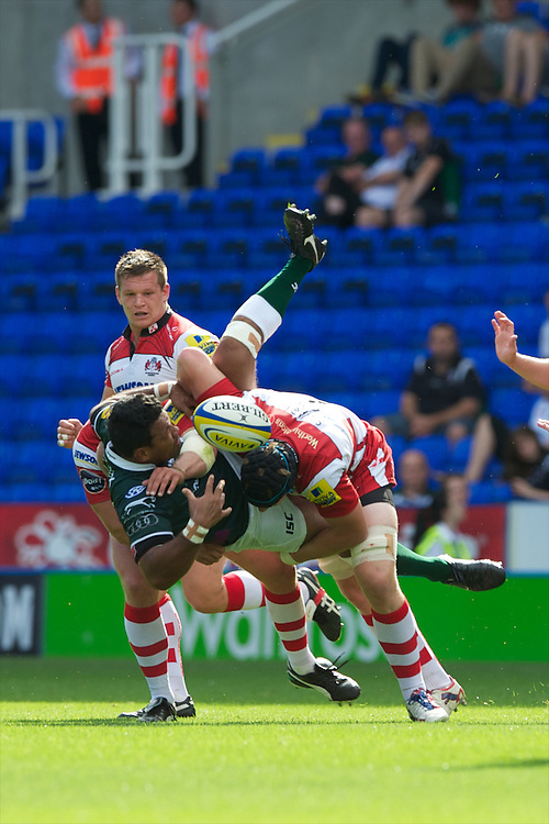 Ofisa Treviranus of London Irish is flattened by Tom Savage of Gloucester Rugby during the Aviva Premiership match between London Irish and Gloucester Rugby at the Madejski Stadium on Saturday 8th September 2012 (Photo by Rob Munro)