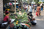 Indian people buy vegetables at Muchi bazzar in Kolkata. India is going through a 21 days lock down for Corona virus pandemic. As the government gave relaxation to lockdown in the morning to shop for daily needs hence neither the social distancing is maitained nor people are using protective masks and gloves, now the authorities are concerned about the spread of the disease. Kolkata, West Bengal, India. Arindam Mukherjee.