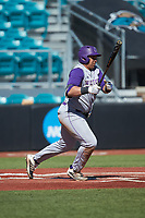 Andrew Bullock (36) of the Western Carolina Catamounts follows through on his swing against the Kennesaw State Owls at Springs Brooks Stadium on February 22, 2020 in Conway, South Carolina. The Owls defeated the Catamounts 12-0.  (Brian Westerholt/Four Seam Images)