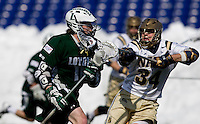 Cooper MacDonnell (16) of Loyola drives on Ian Crumley (34) of Navy at the Navy-Marine Corp Memorial Stadium in Annapolis, Maryland.   Loyola defeated Navy, 8-7, in overtime.