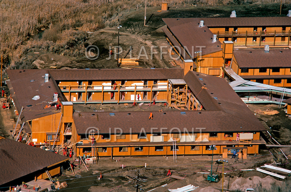 Wasco, Oregon, February 1984: Disciples of Bhagwan Rajneesh working on a construction of a hotel where visitors could stay. Since Rajneeshpuram was established, around 60,000 visitors came every year to take part in the community celebrations. Rajneeshpuram, was an intentional community in Wasco County, Oregon, briefly incorporated as a city in the 1980s, which was populated with followers of the spiritual teacher Osho, then known as Bhagwan Shree Rajneesh. The community was developed by turning a ranch from an empty rural property into a city complete with typical urban infrastructure, with population of about 7000 followers.