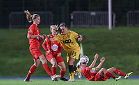 Woluwe's Marie Bougard (10) (L), Standard's Davinia Vanmechelen (25) and Woluwe's Jana Simons (8) (on the ground) in action during a female soccer game between FC Femina WS Woluwe and Standard Femina de Liege on the fourth match day of the 2020 - 2021 season of Belgian Womens Super League , Friday 8th of October 2020  in Liege , Belgium . PHOTO SPORTPIX.BE   SPP   SEVIL OKTEM