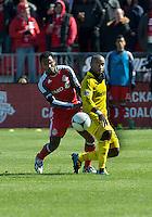 31 March 2011: Columbus Crew forward Emilio Renteria #20 and Toronto FC midfielder Julian de Guzman #6 in action during a game between the Columbus Crew and the Toronto FC at BMO Field in Toronto, Ontario Canada..The Columbus Crew won 1-0.