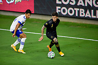 LOS ANGELES, CA - SEPTEMBER 02: Brian Rodriguez #17 of the LAFC moves with the ball past Nick Lima #24 of the San Jose Earthquakes during a game between San Jose Earthquakes and Los Angeles FC at Banc of California stadium on September 02, 2020 in Los Angeles, California.