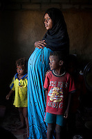 Shaqra Hassan Mohsen, around the age of 30 is married to Ali Hadridi and has seven children. She was married when she was 13 years old and is now nine months pregnant with her eighth child.
