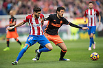 Yannick Ferreira Carrasco of Atletico de Madrid (left) competes for the ball with Daniel Parejo Munoz of Valencia CF during the match Atletico de Madrid vs Valencia CF, a La Liga match at the Estadio Vicente Calderon on 05 March 2017 in Madrid, Spain. Photo by Diego Gonzalez Souto / Power Sport Images