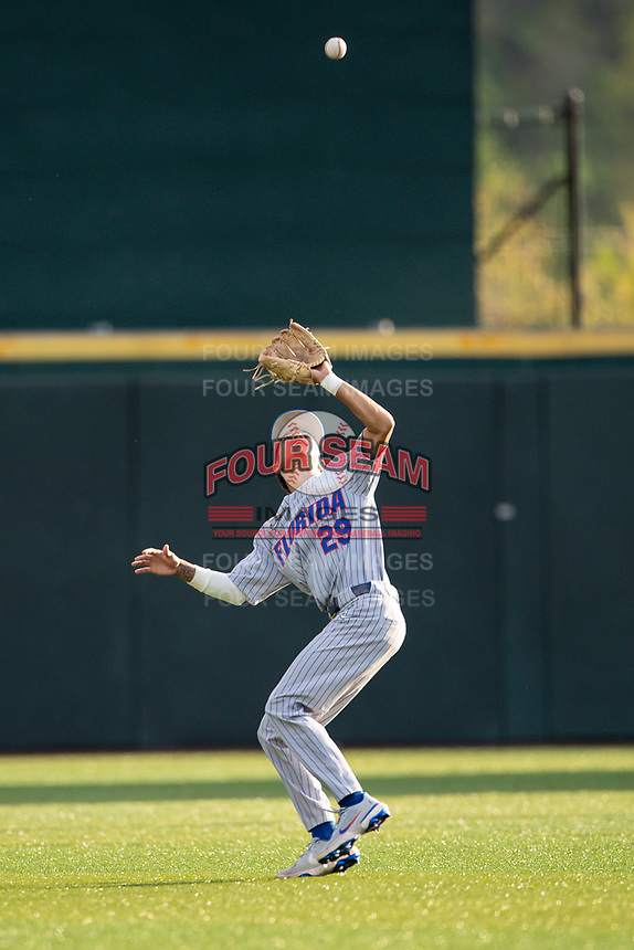 Florida Gators shortstop Jordan Carrion (29) makes a catch against the Tennessee Volunteers on Robert M. Lindsay Field at Lindsey Nelson Stadium on April 9, 2021, in Knoxville, Tennessee. (Danny Parker/Four Seam Images)