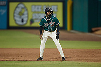 Liover Peguero (10) of the Greensboro Grasshoppers takes his lead off of first base against the Winston-Salem Dash at First National Bank Field on June 3, 2021 in Greensboro, North Carolina. (Brian Westerholt/Four Seam Images)