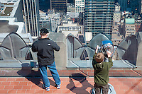 Two people on Top Of The Rock observatioan deck