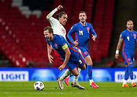 Harry Kane (Tottenham Hotspur) of England is fouled by Yussuf Poulsen (RB Leipzig) of Denmark during the UEFA Nations League match played behind closed doors due to the current government Covid-19 rules within sports venues between England and Denmark at Wembley Stadium, London, England on 14 October 2020. Photo by Andy Rowland.