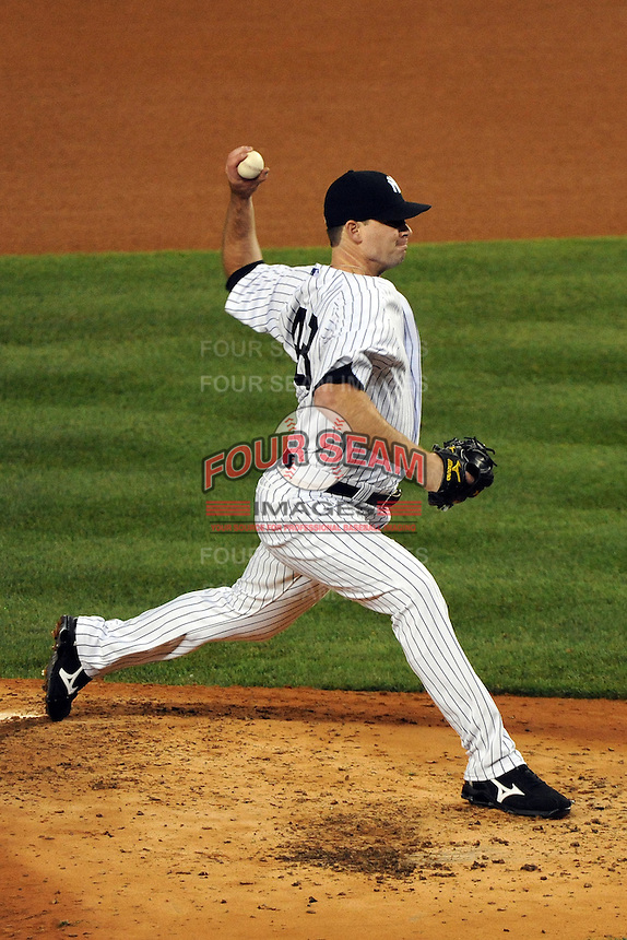 New York Yankees pitcher Boone Logan #48 during ALDS game #5 against the Detroit Tigers at Yankee Stadium on October 06, 2011 in Bronx, NY.  Detroit defeated New York 3-2 to take the series 3 games to 2 games.  Tomasso DeRosa/Four Seam Images