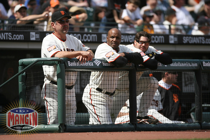SAN FRANCISCO, CA - June 9:  Manager Bruce Bochy, Barry Bonds and Ryan Klesko of the San Francisco Giants watch from the dugout during the game against the Oakland Athletics at AT&T Park in San Francisco, California on June 9, 2007.  Photo by Brad Mangin